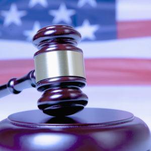 Judge Gavel Against United States National Flag As Symbol Of Jud